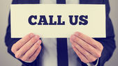 Holding Call us sign — Stock Photo