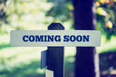Rustic signboard with the words Coming Soon — Stock Photo