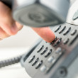 Man dialling out on a telephone — Stock Photo #49390645