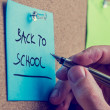Man writing a memo - Back to School — Stock Photo #50196521