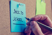 Man writing a memo - Back to School — Stockfoto
