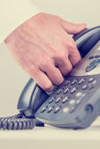 Man gripping a telephone receiver in his hand — Stock Photo