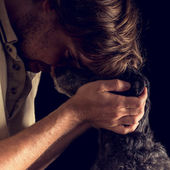 Loving man hugging his terrier dog — Stock Photo
