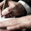 Desaturated image of signing a contract — Stock Photo