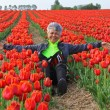 Royalty-Free Stock Photo: Pretty Woman In Dutch Tulip Field