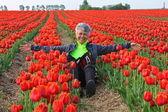 Pretty Woman In Dutch Tulip Field — Stock Photo