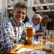 Stock Photo: Happy AustriMDrinking Beer