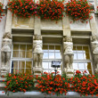 Statues and Flowers Decorate Exterior of a German Hotel — Stok fotoğraf
