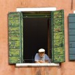 Old Man Watching From An Upstairs Window — Stock Photo
