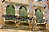 Balconies and Old Wooden Doorways on Venetian Building — Stock Photo