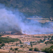 Stock Photo: Stubble fire near to Glozhene Monastery