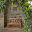 Romantic nook with wood bench and hedge — Stock Photo #29680403