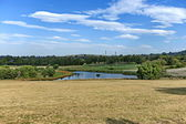 Beautiful landscape with small pond at Emmarentia park — Stock Photo