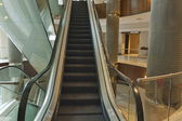 Business buildings interior with escalator — Stock Photo