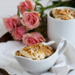 Stock Photo: Nutty dessert and roses