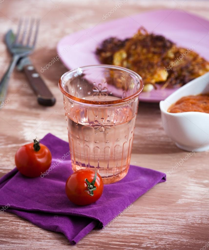 A glass of water with vegetable cutlets  Stock Photo #12832562
