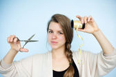 Girl with scissors and packing tape — Stock Photo