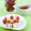 Canape from cheese and grapes — Stock Photo