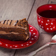 Slice of cake with tea — Stock Photo
