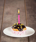 Cupcake with candle — Stock Photo