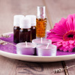 Massage oil with candles — Stock Photo