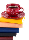 Coffee Cup on Pile of books — Stock Photo