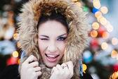 Woman in the winter scenery — Stockfoto