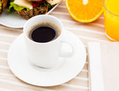 Breakfast with sandwich, coffee and orange juice — Stock Photo