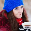 Stock Photo: Girl drinking hot tein winter forest, close up