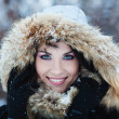Stock Photo: Beautiful winter portrait of young womin winter snowy sce