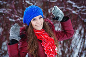 Beautiful winter portrait of young woman in the winter snowy sce — Stock Photo