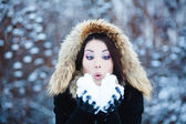 Christmas Girl.Winter woman Blowing Snow — Stock Photo