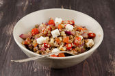 Buckwheat salad with roasted peppers and feta — Stock Photo