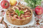 Cheesecake with apples and caramelized pecans — Stock Photo