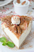 Slice of cheesecake with apples and caramelized pecans closeup s — Stock Photo