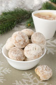 Bowl of gingerbread, fir branches and a cup of cappuccino — Stock Photo