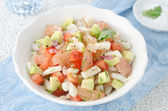A bowl of salad with squid, avocado and grapefruit — Stock Photo