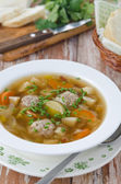 Plate of vegetable soup with meatballs on the wooden table — Stock Photo