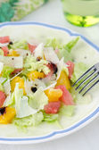Salad with grapefruit, oranges, iceberg lettuce, grated cheese — Stock Photo