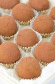 Box of chocolate truffles, selective focus on center — Stock Photo