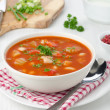 Bowl of roasted tomato soup with beans, celery and sweet pepper - Stock Photo