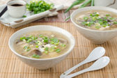 Chinese spicy soup with egg, shiitake mushrooms, tofu — Stock Photo