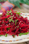 Salad of fresh beets and carrots with parsley closeup — Stock Photo