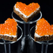 Three sandwich with red caviar in the form of a heart — Lizenzfreies Foto