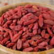 Wooden bowl with goji berries close up horizontal — Stock Photo