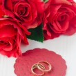 Stock Photo: Red roses and rings for Valentine