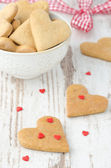 Heart shaped cookies on the table and sugar hearts — ストック写真