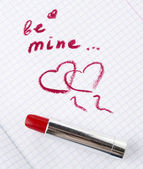 Sign on heart in a notebook and red lipstick in Valentine — Stock Photo
