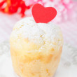 Rum Baba decorated with red hearts on a plate closeup — Stock Photo