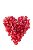 Pomegranate seeds in heart shape isolated — Stock Photo